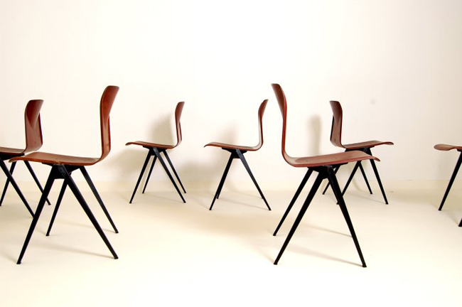 In the manner of Friso Kramer set of 6 Chairs, for Pagholz Very good condition. Can be stacked and connected sideways. Several available. Price: Upon request