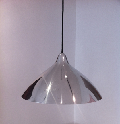 Pair of Lisa Johansson Pape pendant lamps Designed in 1950-51 and produced by Orno 44.5 cm diameter x 24 cm high. In excellent vintage condition. High gloss silver enamel painted hood with ceramic interior.  (Additional pieces available). Price upon request
