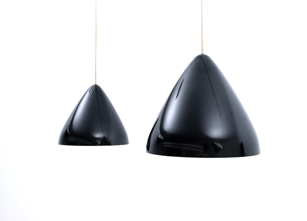 Lisa Johansson Pape lamps   Made by Orno, Finland c. 1953.Pendants in excellent condition. Rare pair by Lisa Johansson Pape in glossy black. . SOLD Please contact us with questions, pricing or shipping details    info@schneidercolao.com
